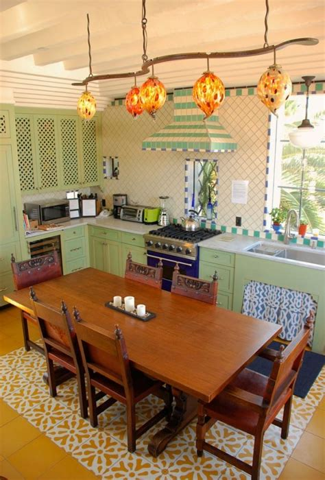 Playful mix of traditional Spanish Revival tiled kitchen