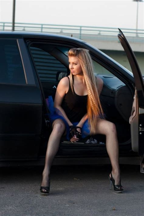 Ladies posing with cars